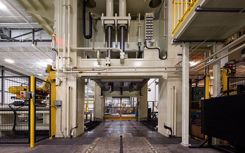 Large manufacturing press that spans floor to ceiling