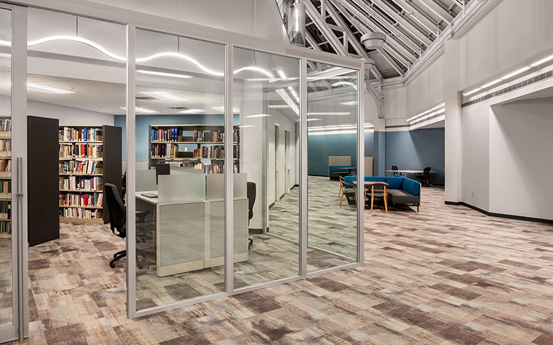 Middlesex London Health Unit library space with glass walls and a vaulted ceiling