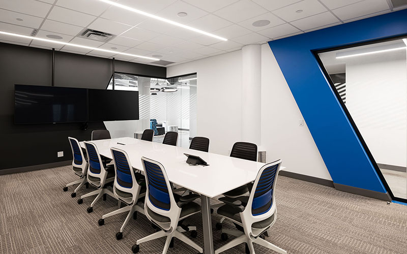 Carfax boardroom with white table and chairs, blue accent on white walls.