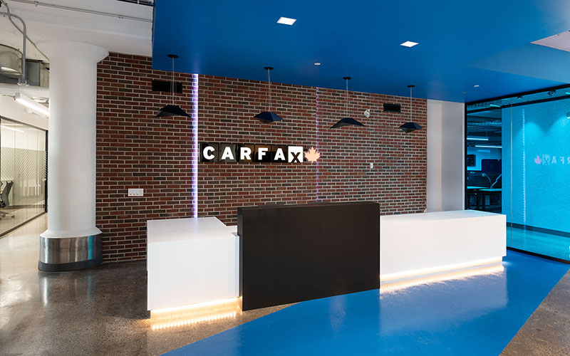 Carfax front Reception area with desk and Carfax Logo on the back wall. Blue ceiling with blue on the floor as well.