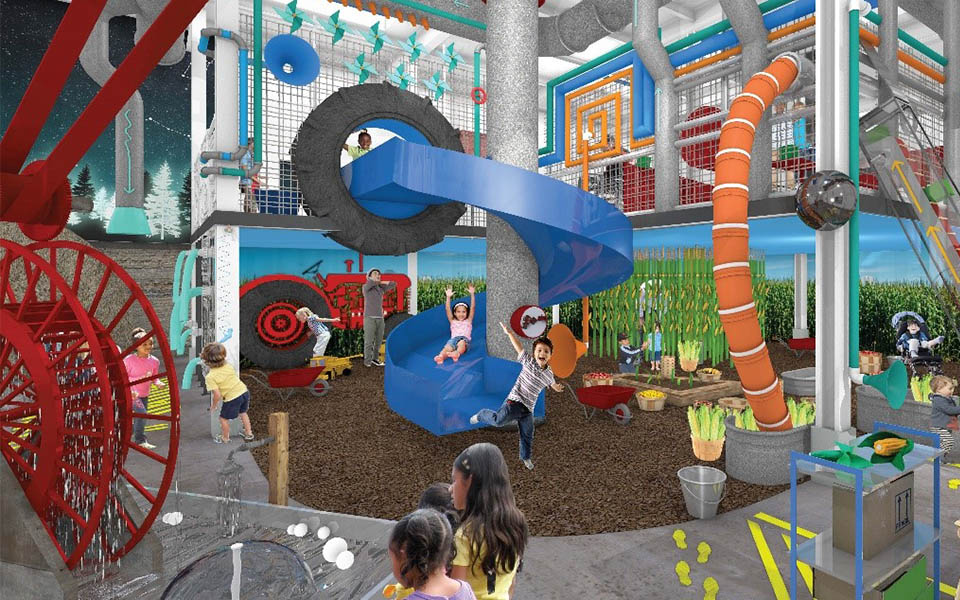 Children's museum, institutitional facility construction, children playing in a playroom with climbing structures and slides as well as a water area.