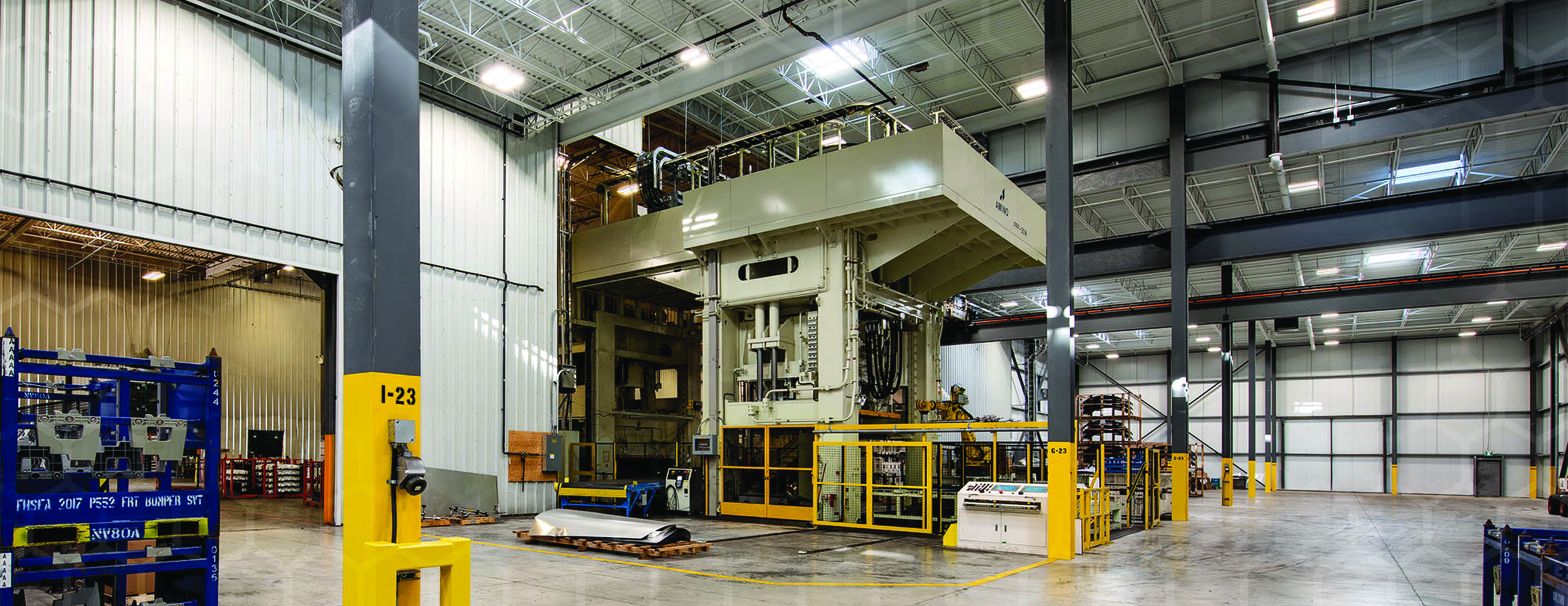 Interior Photo of Amino Facility showing a large floor to ceiling industrial press