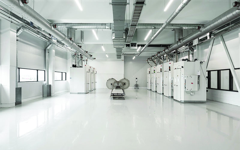 Starlim Production area, with automated machines and white large bay door on the left.
